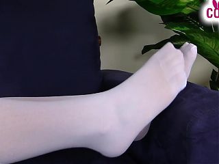 Horny nurse in stockings plays with her shoes and feet