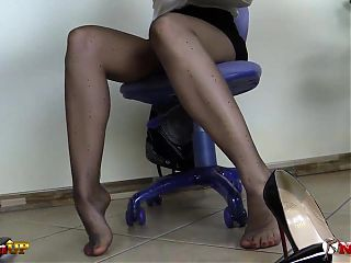 Redhead secretary in pantyhose masturbates with her sex toy
