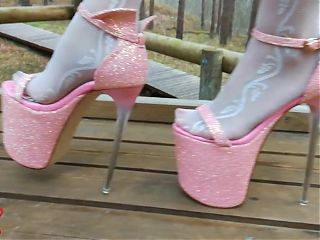 Lady L walking in towering pink extreme high heels.