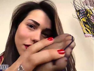 Supergirl in pantyhose sniffing her own feet