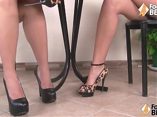 Hot barefoot girls take off heels and play footsies