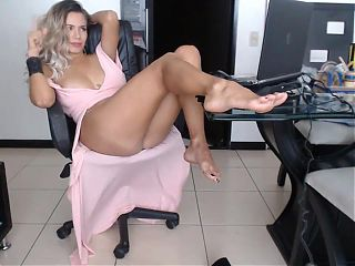 Secretary removes thigh boots to show amazing legs & feet.