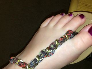 Sexy feet purple nails with beautiful ribbon thong sandals